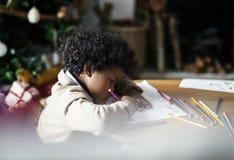 享用彩图的非洲孩子 库存照片