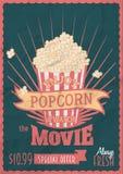 享用玉米花并且观看电影 海报与玉米花桶的设计模板 图库摄影