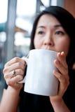 享用茶的4个杯子 免版税库存照片