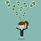 享用金钱雨的愉快的年轻女实业家 库存照片