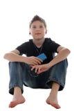 享用音乐年轻人的男孩 免版税库存图片