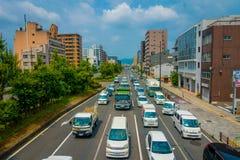 京都,日本- 2017年7月05日:汽车鸟瞰图在京都街道上的在日本 京都大都会是其中一个多数 免版税库存图片