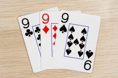 3亲切的nines 9 -打啤牌牌的赌博娱乐场 免版税库存照片