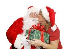 亲吻圣诞老人感谢您 库存照片
