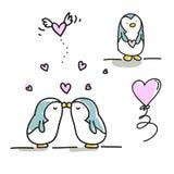 亲吻夫妇的企鹅 免版税库存照片