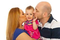 亲吻母亲的惊奇小父亲 库存图片