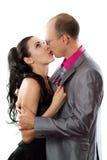亲吻爱恋的妻子的夫妇丈夫 免版税库存照片