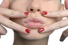 亲吻s妇女的特写镜头表面 免版税图库摄影