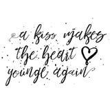 亲吻再做心脏年轻人 免版税库存照片