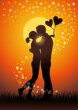 亲吻夫妇sihouette的恋人 库存图片