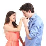 亲吻手的人对他的伙伴 免版税库存照片