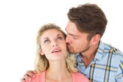 亲吻面颊的英俊的人女朋友 库存照片