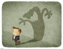 人一个恼怒的人的铸件阴影 免版税库存照片