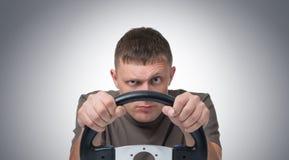 人与轮子的汽车司机 免版税库存图片