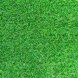 人为绿草纹理或绿草背景高尔夫球场的 足球场或体育背景 库存照片