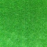人为绿草纹理或绿草背景高尔夫球场的 足球场或体育背景 免版税图库摄影
