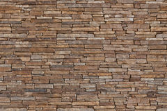 人为蓝色轻的石墙 免版税库存图片