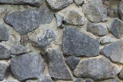 人为蓝色轻的石墙 图库摄影