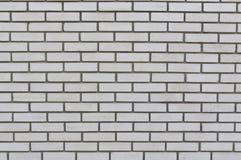 人为蓝色轻的石墙 免版税库存照片