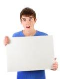 年轻人举行空白板 免版税库存照片