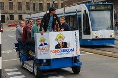人乘坐的游览在阿姆斯特丹,荷兰骑自行车 库存图片