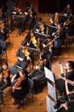 人使用在一个古典音乐音乐会的,瓷 免版税库存图片