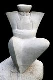 人供以座位的雕象 免版税库存照片