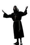 人修士教士剪影祈祷 免版税库存照片