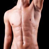 人冒汗了露胸部的躯干 免版税库存照片