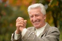 人前辈微笑 库存图片