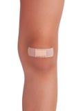 人力膝盖,被密封的膏药 免版税库存图片