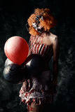 令人厌恶的女性小丑 免版税库存照片