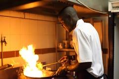 黑人厨师环境画象  库存照片