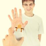 年轻人否认香烟 图库摄影