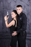 人和一个女孩有枪的 库存图片
