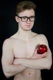 人和一个红色苹果 免版税库存图片