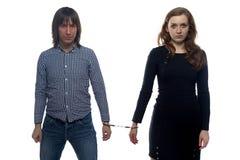 年轻人和不快乐的妇女 库存照片
