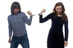 年轻人和妇女的交锋 免版税库存图片