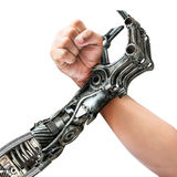 人和机器人武器角力 免版税库存照片