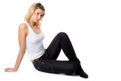 年轻人和秀丽女孩牛仔裤的 免版税库存图片