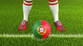 人和足球与葡萄牙旗子 免版税库存图片