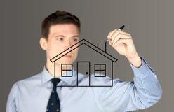 人图画房子 免版税库存照片