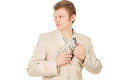 人在他的矿穴放置货币并且查找  免版税库存照片