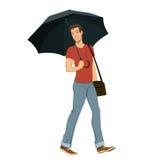人在伞下 库存图片