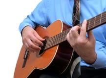 人在吉他使用 免版税图库摄影