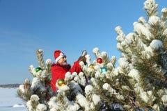 人在圣诞老人的衣服 库存照片