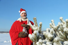 人在圣诞老人的衣服 免版税库存照片