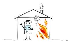 人在房子&火里 免版税库存图片