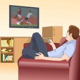 人在沙发和观看说谎在电视的一场足球比赛 休息父亲在工作以后 免版税图库摄影