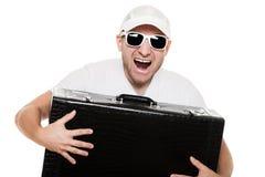 人在现有量的藏品手提箱 免版税库存图片
